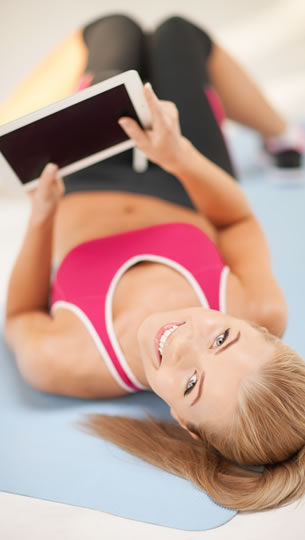 personal trainer with tablet